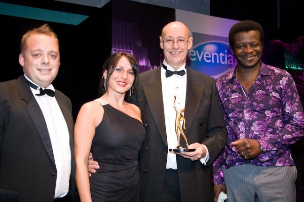 Sponsor John Burgess of Stage Electrics (left), and comedian Stephen K Amos (right) congratulate Tash O'Neil and Nick Blandford of Cornwall Enterprise.