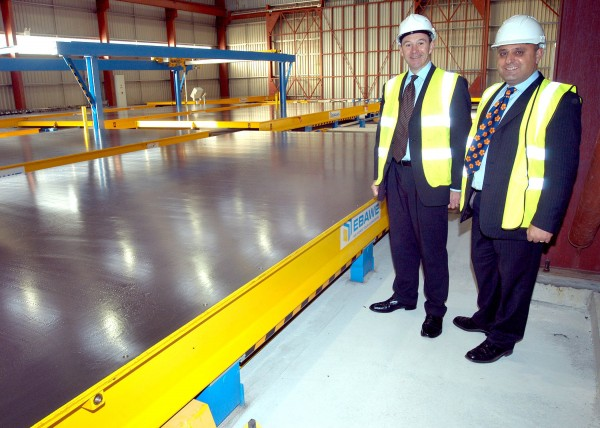 UK 'FIRST.'  Ewan McClymont (left), head of grant services at Bishop Fleming, and David Moses, managing director of Cornish Concrete Products Ltd, pictured with the company's market-leading new automated circulating carousel plant.