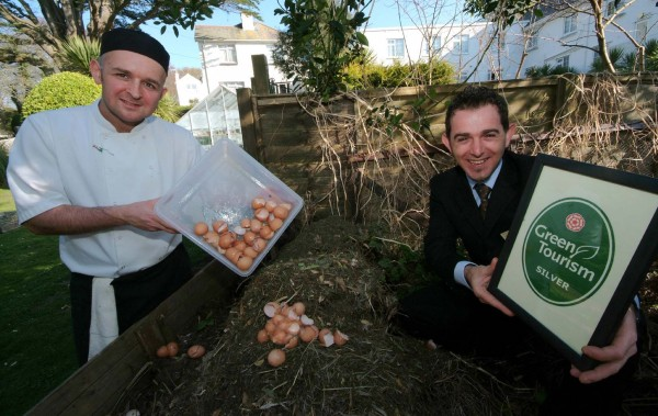 Reception manager and Green Team leader Zafer Kuru and chef de partie Lee Steadman, recycling breakfast waste onto the compost heap.