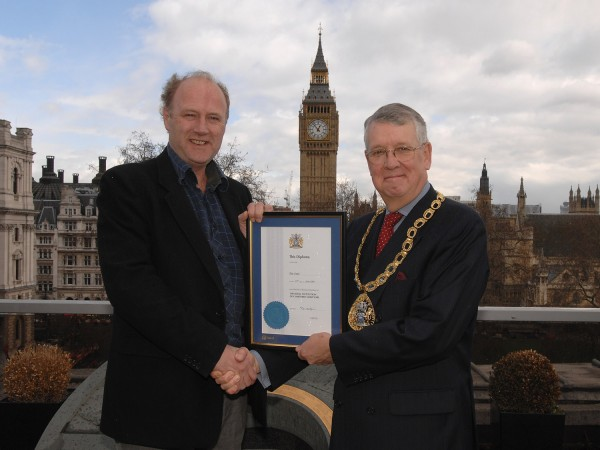 Tim Smith (l) receives his Honorary Membership from RICS President Peter Goodacre
