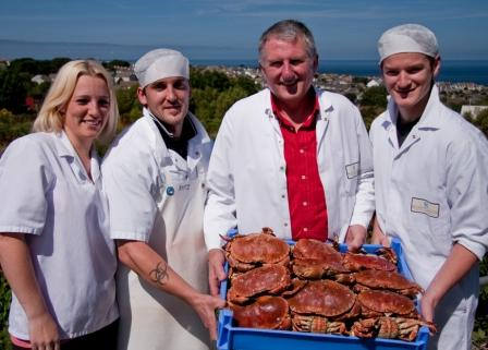 L-R: Charlene Button, Richard Button, Matthew Stevens, Jacob Billinger at the opening of the new crab processing facility on the Penbeagle Industrial Estate, St. Ives