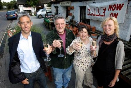 Jon and Sarah Keast (left and right) celebrate the launch of Scarlet Wines business with former Old Forge owners David and Janet Moran