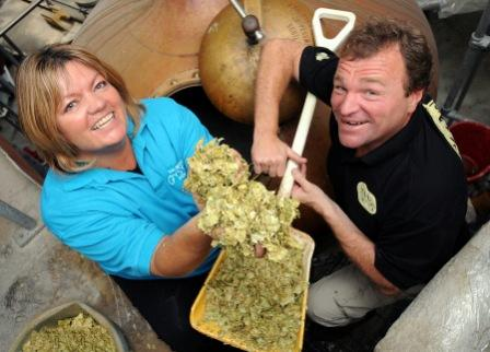 Sian Robbins of Visit Cornwall joins Steve Skinner in the ceremonial feeding-in of the ingredients for the Cornish stout