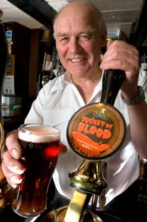 Rick Shackelton, the Bucket of Blood landlord pours the first pint of St Austell Brewery's latest seasonal ale