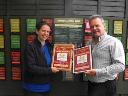 Rosalind Smith from Newquay Zoo presents Jim Kane from Par Sands Holiday Park with Conservation Club membership