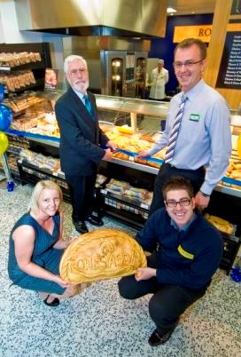 Rebecca Sinnamon, Rowe's project manager (front left), Paul Pearce, Rowe's director of marketing (front right), Brian Palmer, Mayor of St Austell (back left), Andy Hollidge, Asda store manager (back right)