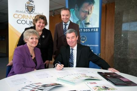 Lorrie Eathorne-Gibbons and Carol Wells, the FSB's national vce chairman, sign the Accord documents with Kevin Lavery and Alec Robertson
