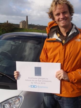 Robin van der Bij of Ecohouse with the company pledge to reduce fuel emissions by 10% in 2010 using their new Smart car