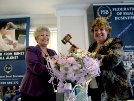 Lorrie Eathorne-Gibbons is handed the 'gavel' as she takes over as Regional Chairman from Carol Wells