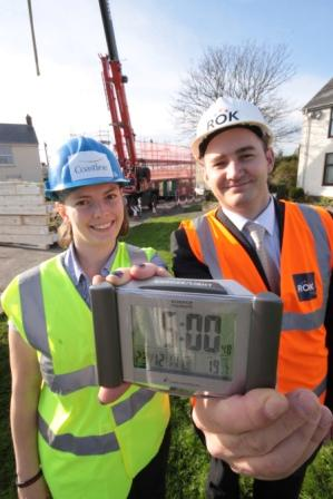Coastline's Cathy Thomas, development administrator, and Rok's Paul Postlethwaite hold the ticking clock