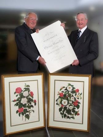 Michael Galsworthy (r) receiving his parting gifts from President of the Duchy Health Charity Robert Robins