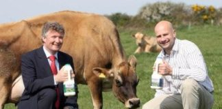 L-R: Nicholas Rodda, a cow, and new hotel owner Clifford Freeman