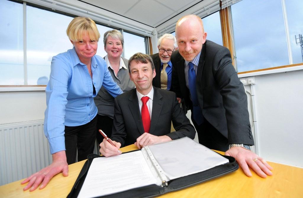 Darren Dixon (centre) and the CF Systems team