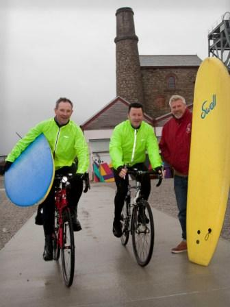 L-R: Ewan McClymont, William Allen, and Russ Pierre, director at Surf Action, preparing for the charity cycle marathon