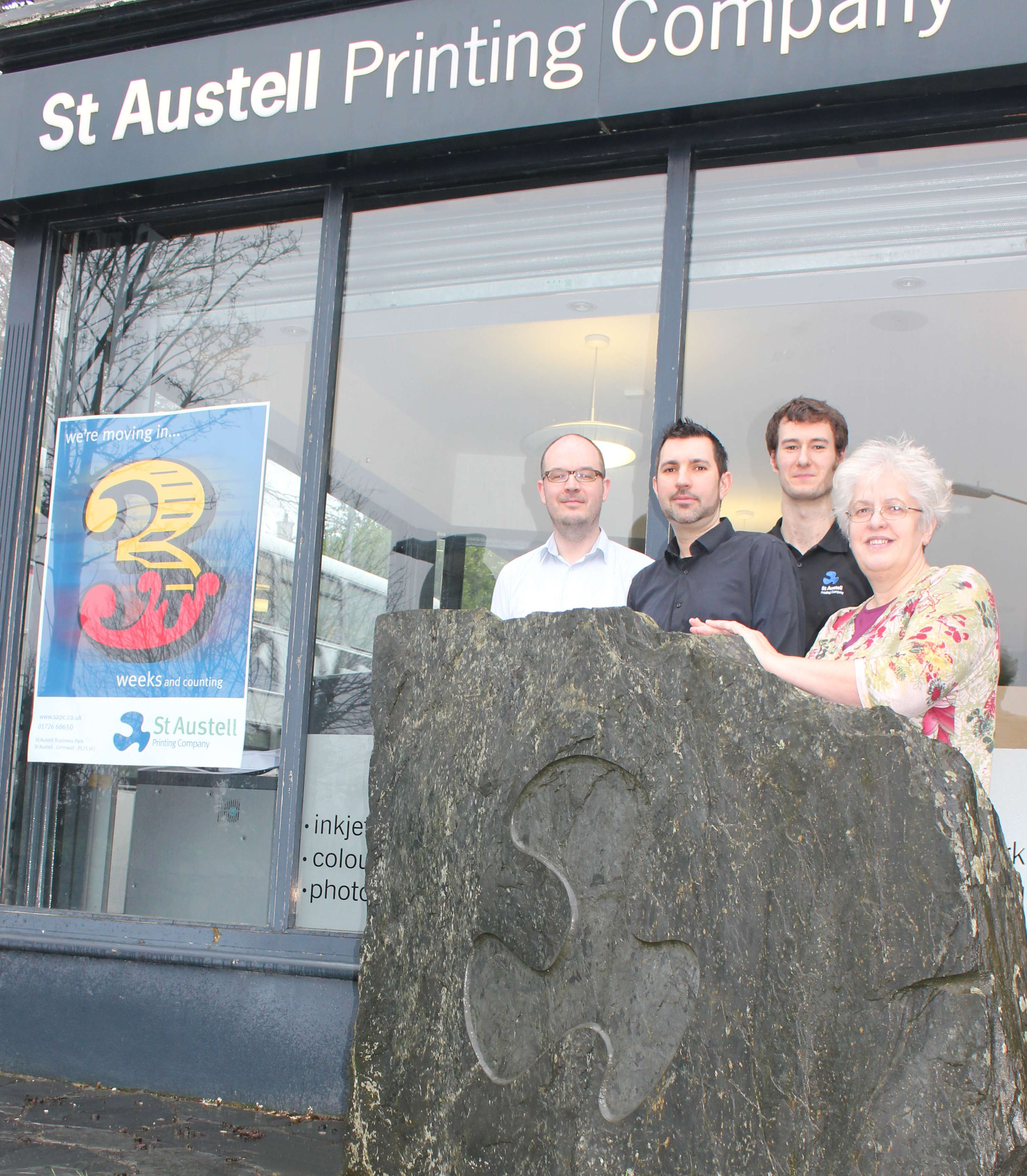 Getting ready for St Austell Printing Company's move are Mark Naylor (Reproduction Department), Ian Dibb (Digital Department), Dan Ferguson Smith (Print Department) and Mary Allen (Accounts Department)