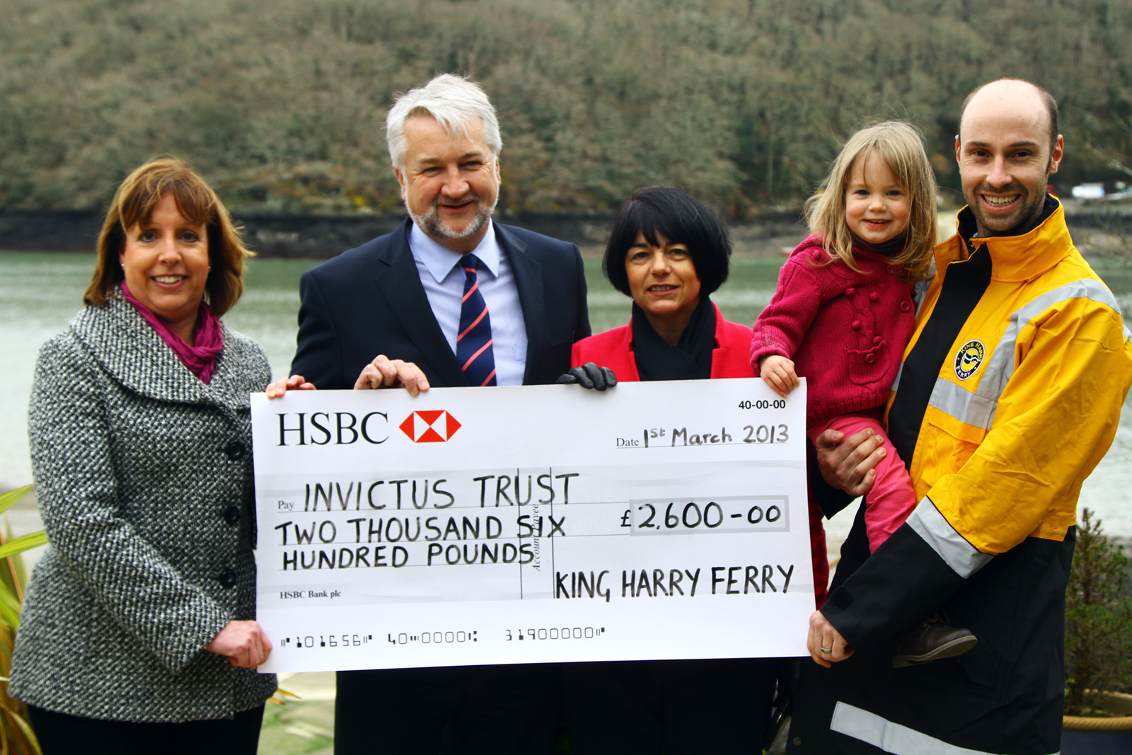 Handing over the donation from the King Harry Ferry's foot and cycle passengers are (L-R): Beverley Hayward (King Harry Ferry), Steve and Sharon Cowburn (Invictus Trust), Garrick Royle (King Harry Ferries' operations manager) and his daughter, Molly.