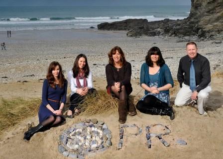 On the beach: The Sue Bradbury PR team with Georgia Clancy far left