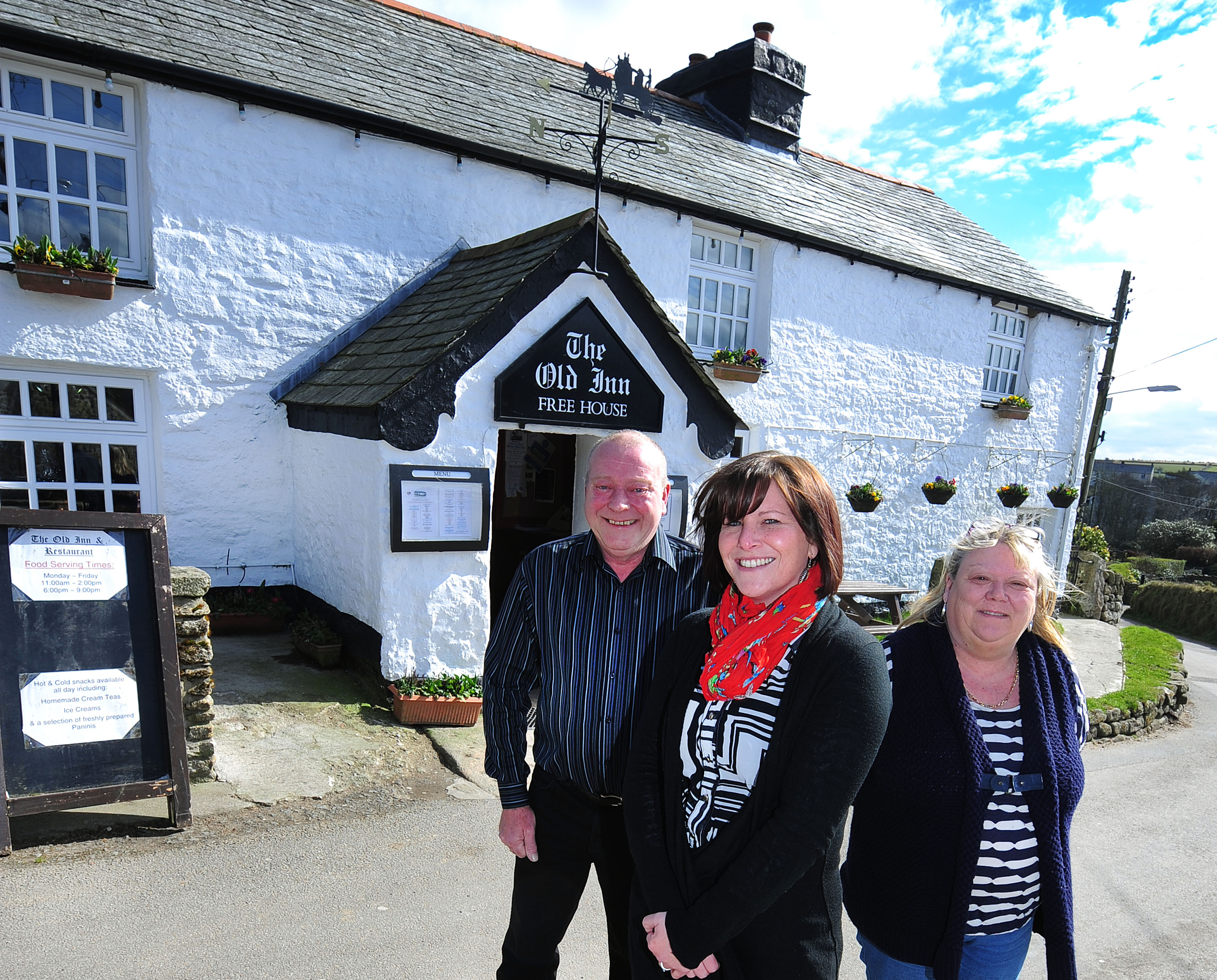 Worldwide Financial Planning's Rebecca Bendle (centre) with the Old Inn's new landlords, Melvyn and Christine Hooper