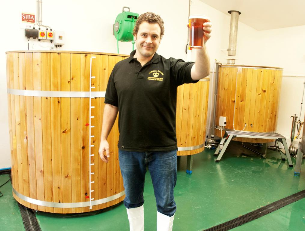 Josh Dunkley raises a glass at the Cornish Crown Brewery