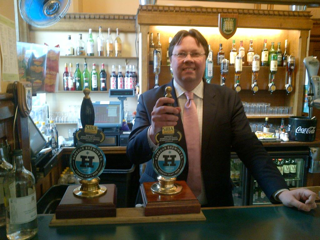 Dan Rogerson MP ready to serve a pint of Cornish ale behind the Strangers' Bar in the House of Commons