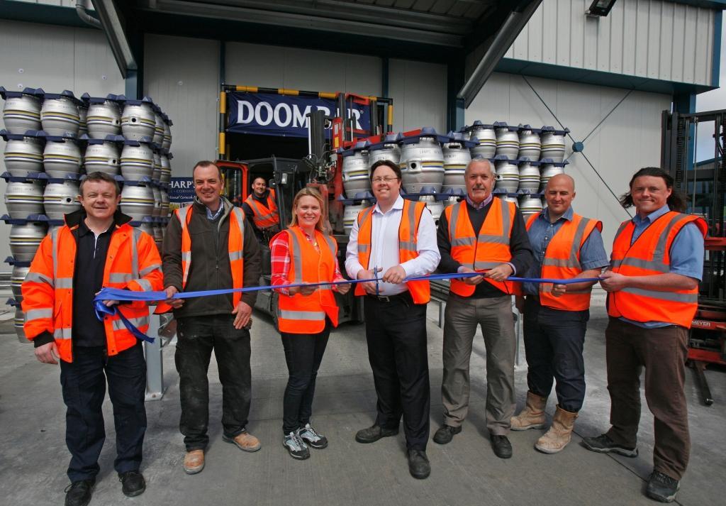 Dan Rogerson (centre) opens the new Sharp's cold storage facility