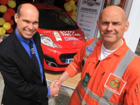 Johnny Hawkins and paramedic Mick McLachlan with the Peugeot 107 donated to the Cornwall Air Ambulance Summer Prize Draw