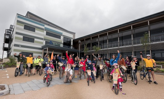 The audience and their steeds ready to leave St Austell Business Park on the cycle trail of Don Quixote