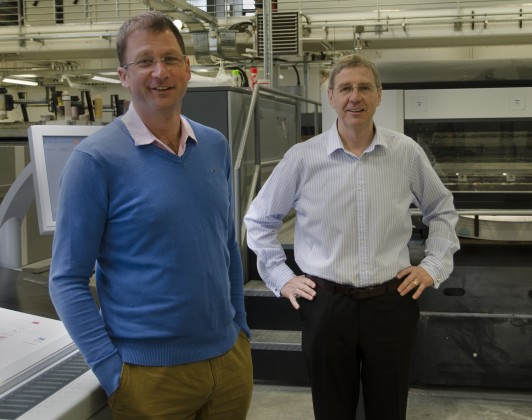 Clean Cornwall's Henry Orchard (left) with St Austell Printing Company's Peter Moody. The St Austell Business Park based firm has supported the Clean Cornwall project to spread its message