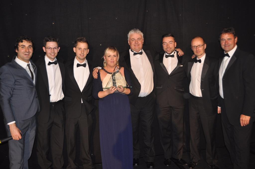 Glyn Pascoe and Josh Hosking from iCT4 (2nd and 3rd from left) pick up their award with the rest of the MXSweep team