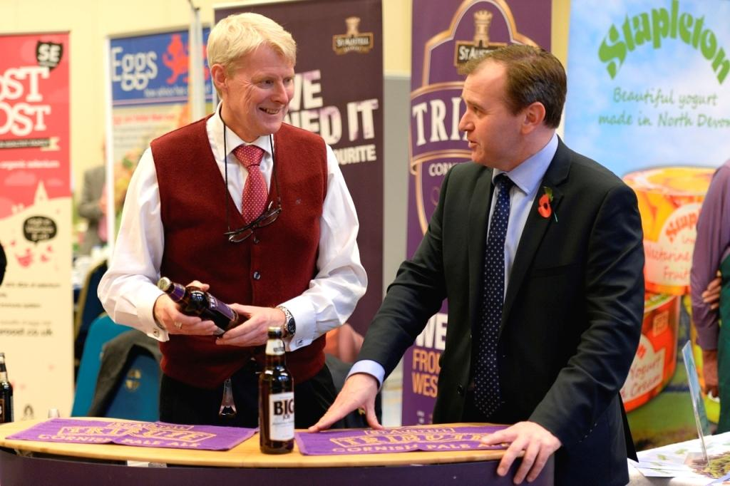 St Austell Brewery's trade marketing manager, Marc Bishop (l), with Camborne MP, George Eustice at the Tesco local supplier event at Westminster