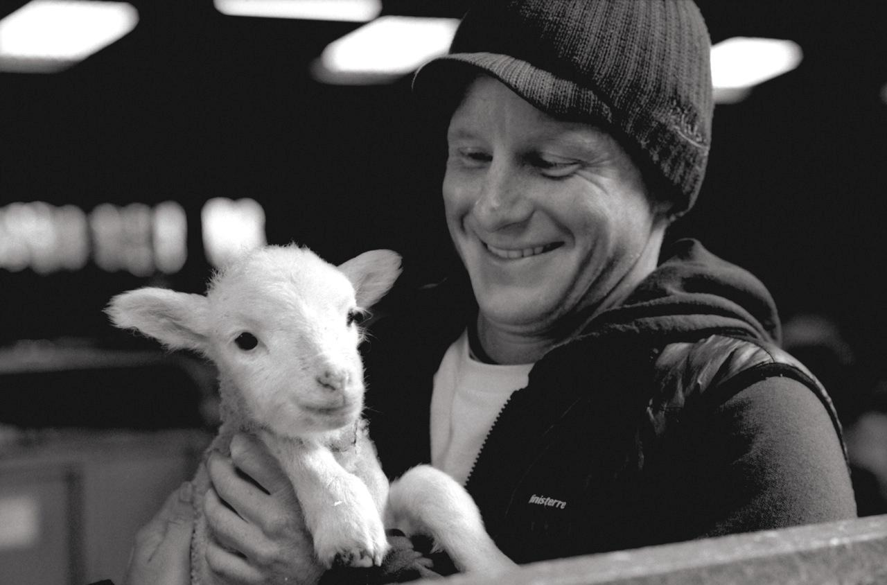 Finisterre founder Tom Kay with a Bowmont lamb