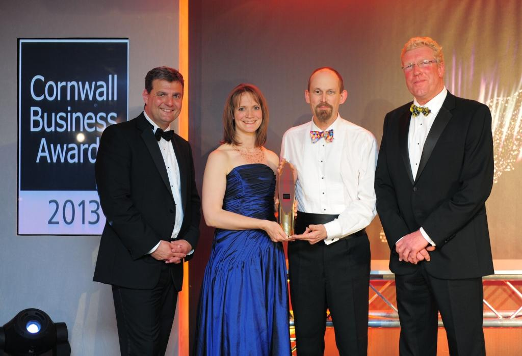 Last year's Winner of Winners Cycle Engineering with Cornwall Chamber chief executive Kim Conchie (r) and guest speaker Dr David Bryon