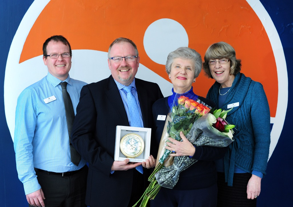 Jill Luff, receives a clock and flowers from the trust's vice chairman Mark Smith, and is also joined by the centre manager, Barry Holding and trustee, Janet Cormack