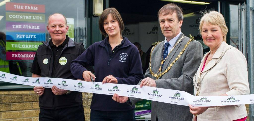 Cornwall Farmers cut the ribbon to its second Patch & Acre country store on Saturday 12 April, 2014. David Gordon, Mayor of Launceston and Claire Butter, Chair of Cornwall Young Farmers, led the opening ceremony with store manager David Shadrick. Images may be used free of charge subject to the following conditions: 1) The image is used in publicity or editorial material promoting Cornwall Farmers or Patch and Acre, provided the use of each image is strictly non-commercial. 2) The photographer is credited as indicated above. 3) Images may not of themselves be used to generate income, nor be sold, or given, for use to third parties.