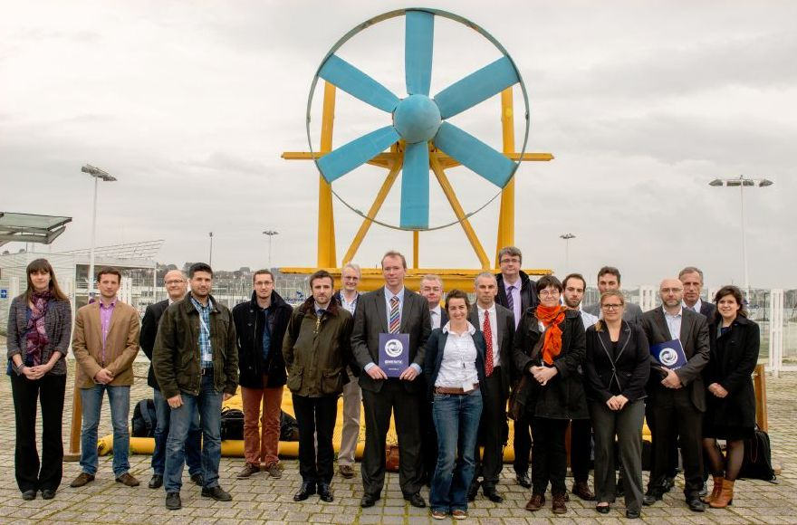 Conference delegates  in front of 'Sabella', a tidal turbine device used as a pilot project