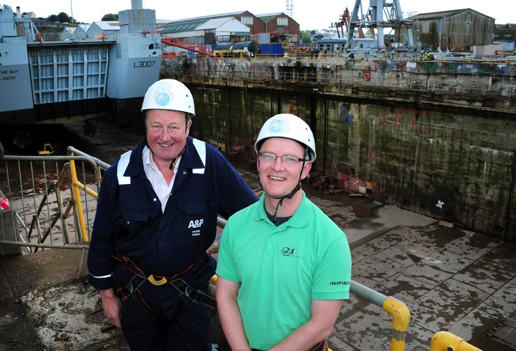 Peter Child (l) and Adrian Richards prepare to abseil