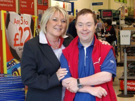 Pluss customer Darren Richards and his boss Debbie, at work at Tesco, Tolgus