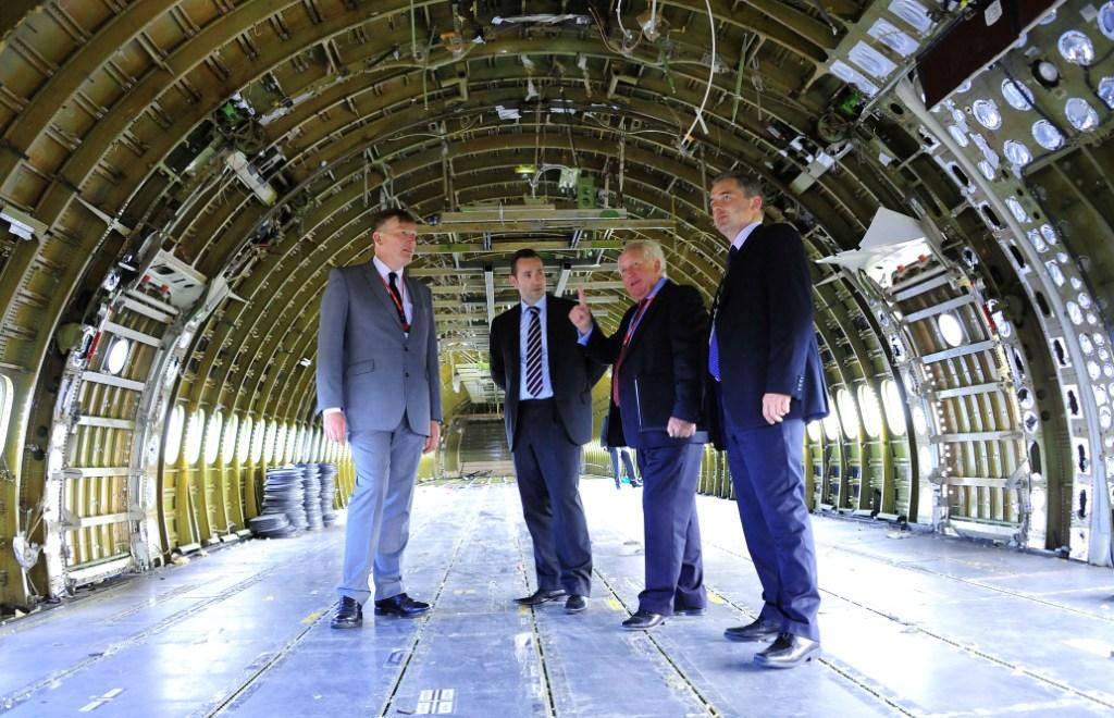 L-R: Local Growth Minister Kris Hopkins; Newquay Airport MD Al Titterington; LEP chairman Chris Pomfret and Enterprise Zone manager at Cornwall Development Company, Miles Carden inside a DC10 being dismantled by Apple Aviation at Aerohub