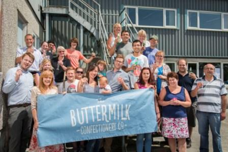 The Buttermilk Confectionery Co team celebrates the purchase of a new factory, which will double its production space and increase output. The family-run business has invested around £500,000 in the new factory, which is due to be operating by January 2015.