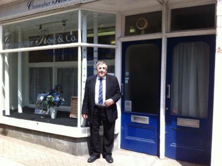 Christopher outside his Penryn office