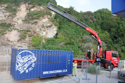 Crane sailing at Crinnis Beach. Meals on wheels was given a new twist as St Austell metal recycler, Henry Orchards and Sons, helped Sam's Cornwall, move its latest venture into place
