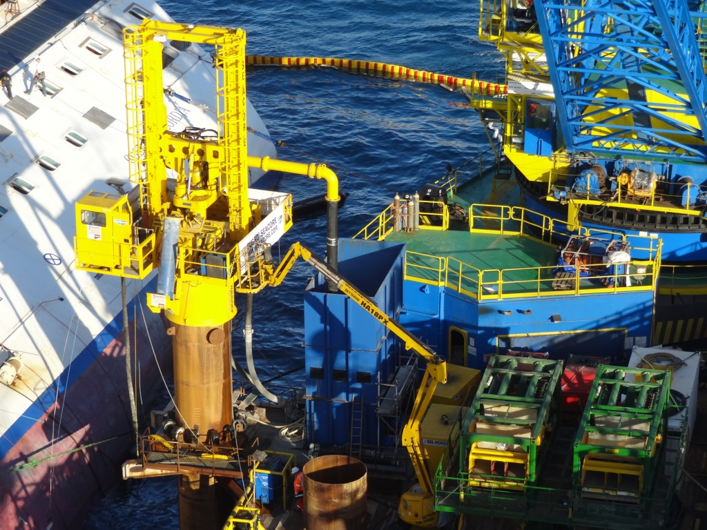 Drilling equipment, designed and built in Falmouth by Fugro Seacore, lays the foundations for the recovery of the Costa Concordia