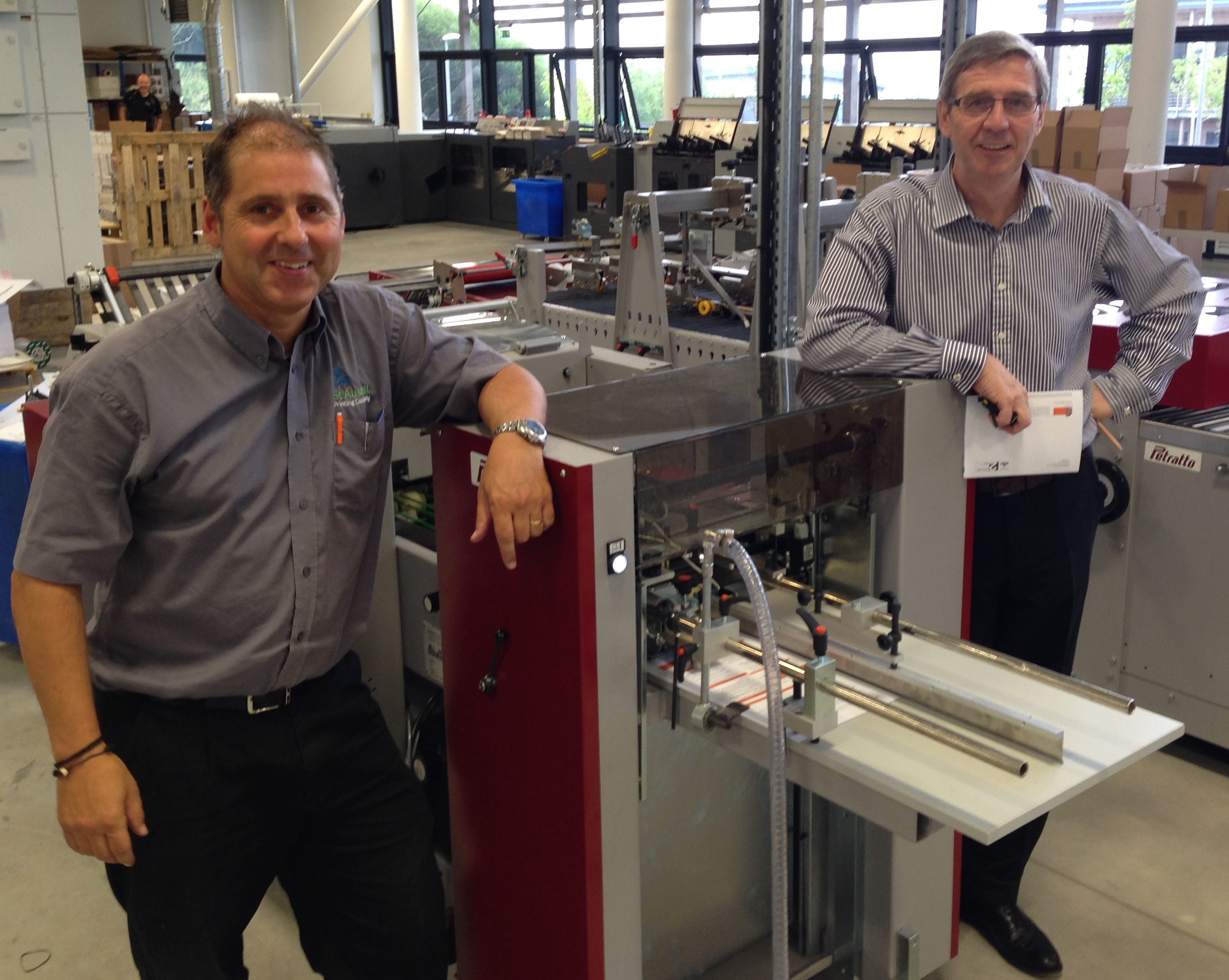 St Austell Printing Company's bindery manager Anthony 'Tux' Tucker (left) and managing director Peter Moody with the new equipment from Italy. The duo spent a week in Italy testing the new equipment.