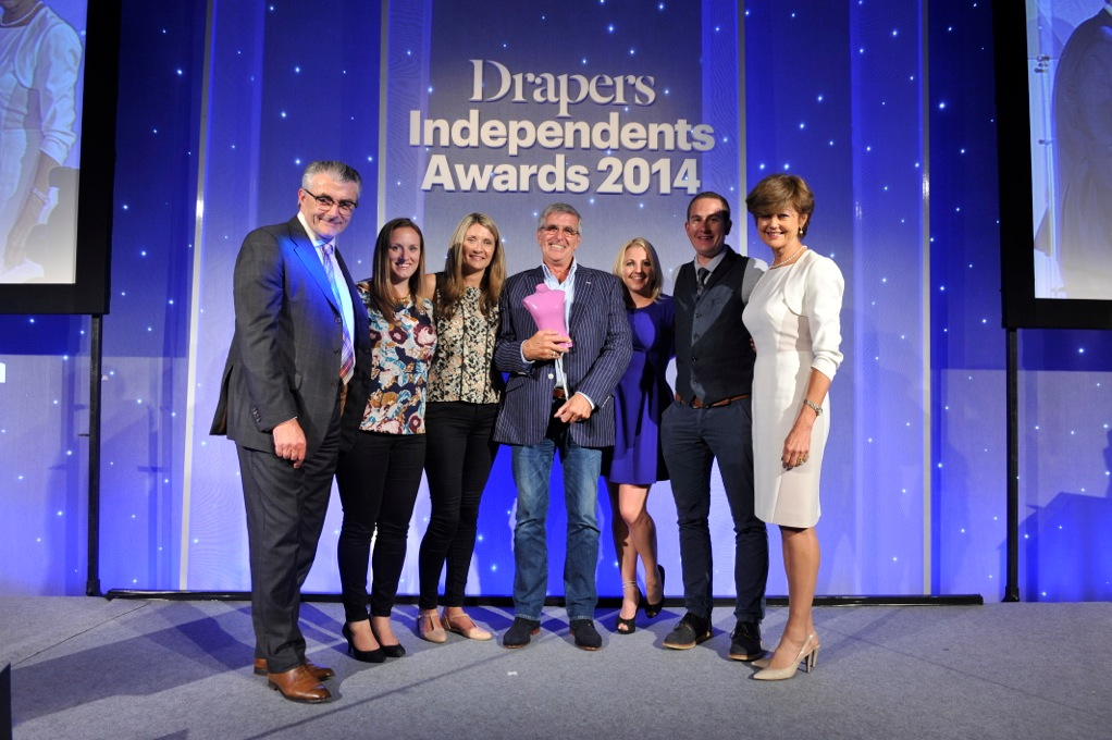 Ann's Cottage director and owner Rob Harris (centre) receives the award for Lifestyle Independent of the Year