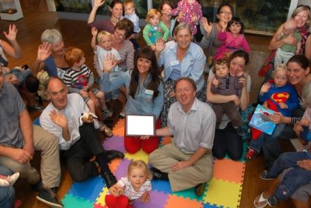 Staff and volunteers celebrate with families after winning the 2014 Family Friendly Museum Award
