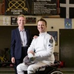 Kate McCavana, Grant Funding Consultant at K2 Funding, stands alongside recently sponsored paralympic fencing hopeful, Matthew Campbell-Hill. Image taken inside Truro school fencing building. Sept/14Image by John Liot