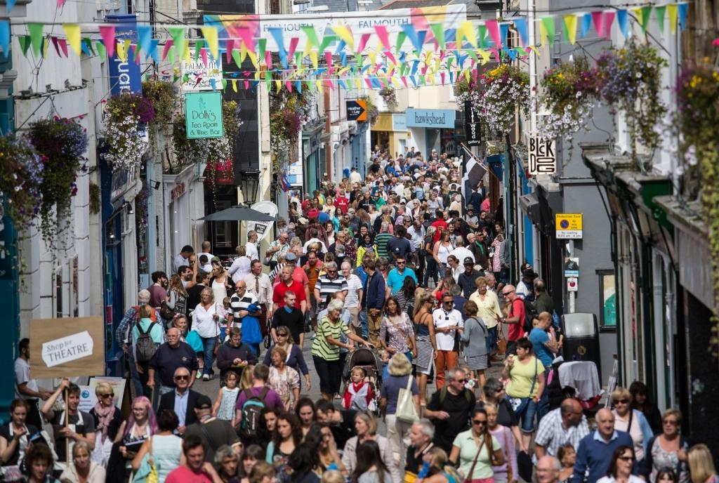 Visitors on High Street enjoy the festivities of Falmouth Tall Ships, Cornwall, UK