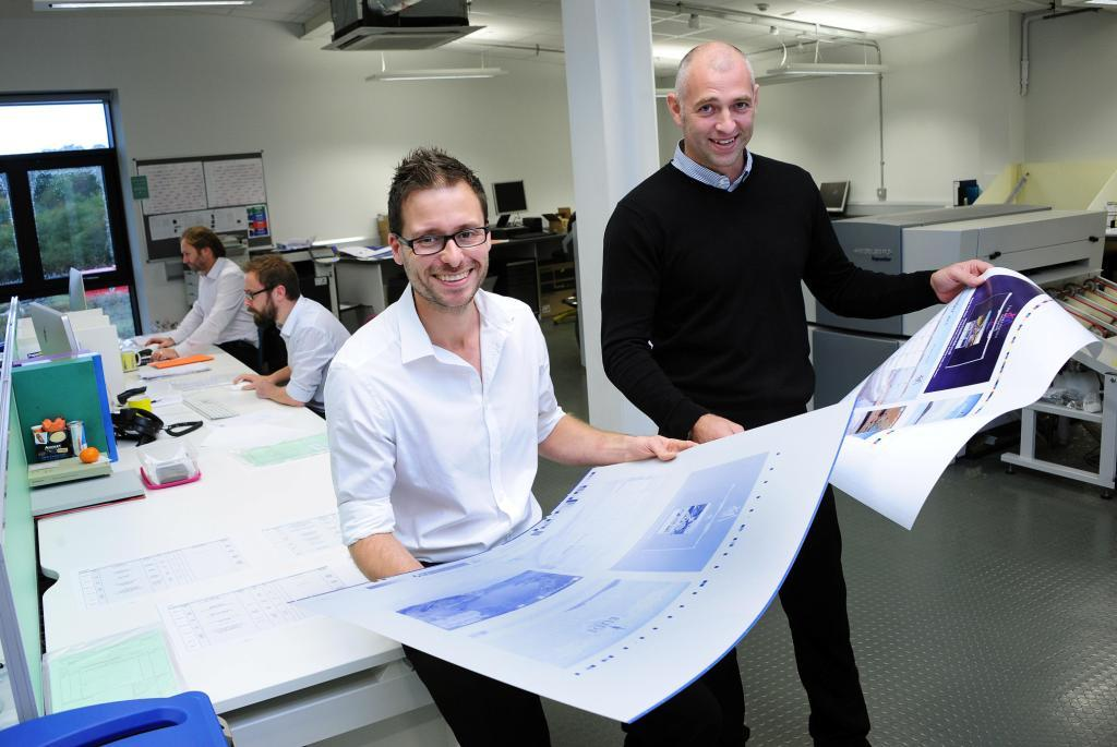 St Austell Printing Company's Gavin Rowett (left) and Dan Oates, who both work in the Pre Press Department. The print company's new investment will save 800 litres of water per day
