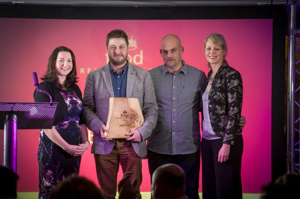 Rupert Wilson (second from left) receives Best Food Pub award at the Food Magazine Readers Awards