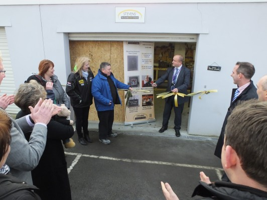 Anne Marlow and Pat Scully of Stephens Cornish Slate watch with guests while Richard Scutt (right) cuts the ribbon